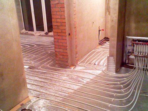 Водяное отопление под полом частного дома своими руками
